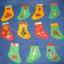 nogavičke in mošnjički, ki so služili za adventni koledarček moji hčerkici - barvn papir,