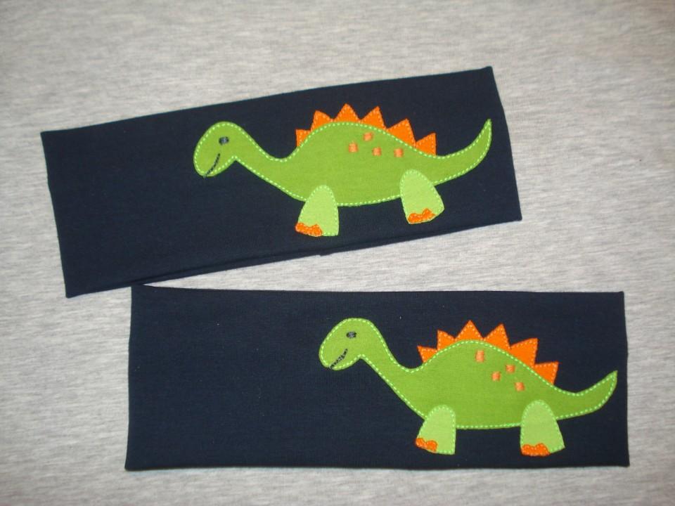 trak za ušesa dinozaver
