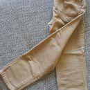 Žametne bež hlače, št. 110, oblečene enkrat, cena: 2,00 €.
