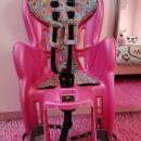 Otroški sedež za kolo v roza barve 30€