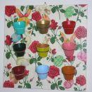 slika s keramičnimi lončki za pirhe