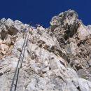 Strmo plezanje v ferrati Giuseppe Olivieri na Punta Anno