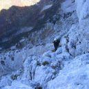 Pogled iz Tumove smeri na Trebiški dol z lovsko kočo